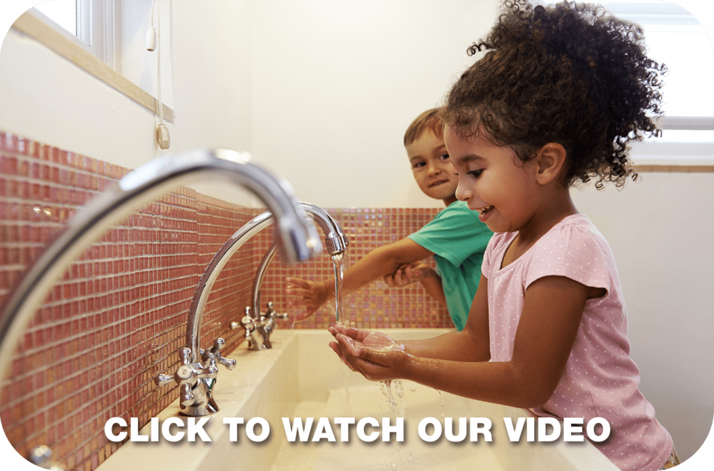 two kids washing their hands